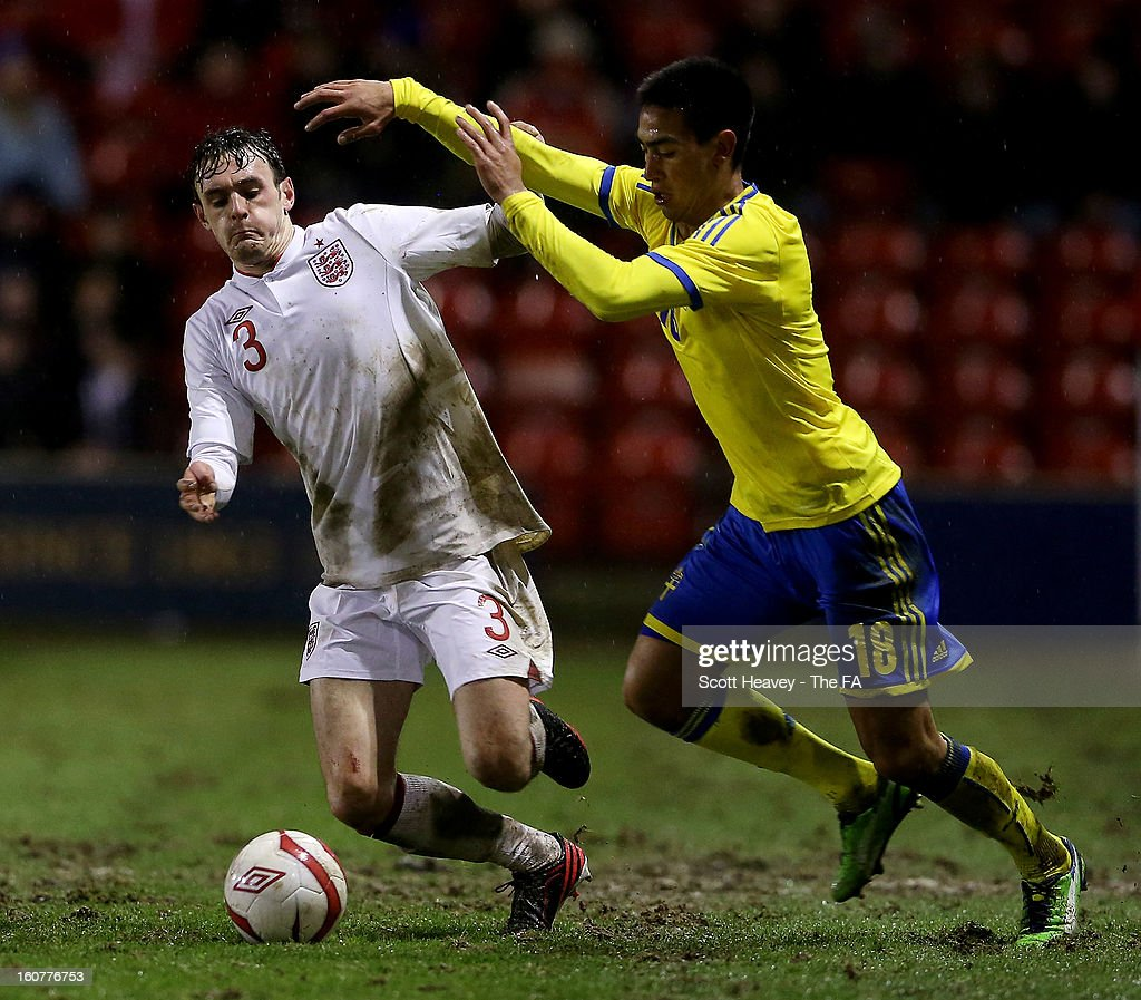 Jack Robinson of England (L) in action with Amin Nazari of Sweden during the International Match between England Under 21's and Sweden Under 21's at Banks' Stadium on February 5, 2013 in Walsall, England.