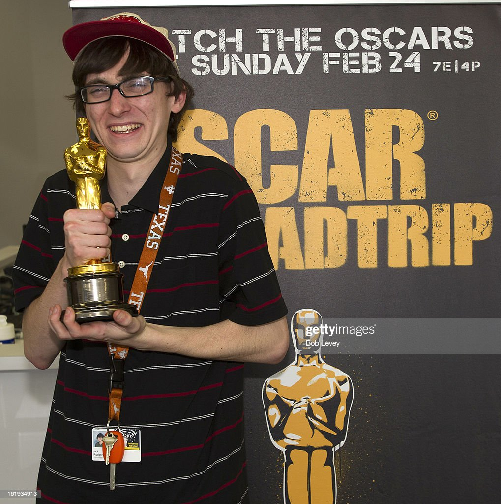 Jack Rodgers of Houston, holds the Oscar statue during the First-Ever Oscar Roadtrip on February 17, 2013 in Houston, Texas.