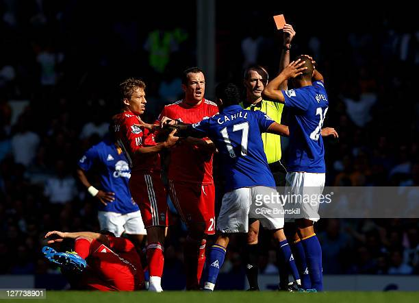 Jack Rodwell of Everton is shown a red card by Referee Martin Atkinson following a challenge on Luis Suarez of Liverpool during the Barclays Premier...