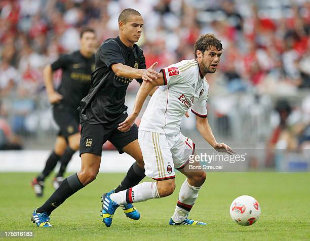 Jack Rodwell of Manchester challenges Andrea Poli of Milan during the Audi Cup 2013 semifinal match between Manchester City and AC Milan at Allianz...