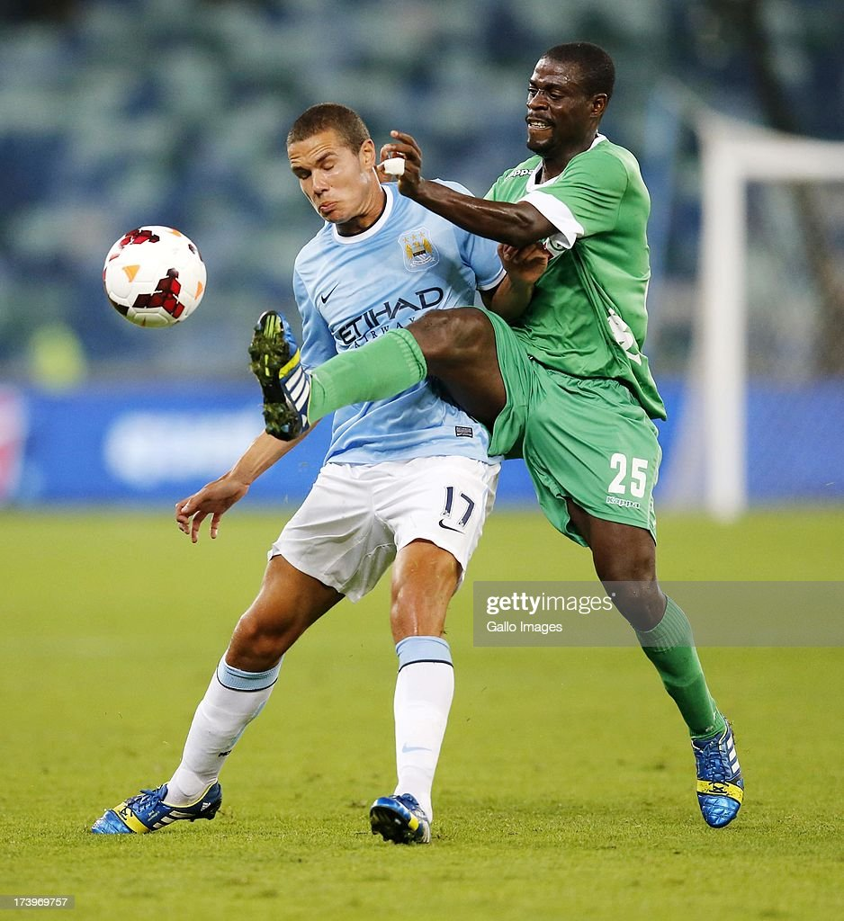 Jack Rodwell of Manchester City battles with Mohammed - Awal Issah of Amazulu during the Nelson Mandela Football Invitational match between AmaZulu and Manchester City at Moses Mabhida Stadium on July 18, 2013 in Durban, South Africa.
