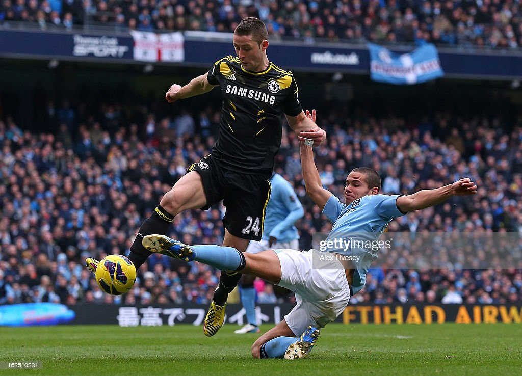 <a gi-track='captionPersonalityLinkClicked' href=/galleries/search?phrase=Jack+Rodwell&family=editorial&specificpeople=4266551 ng-click='$event.stopPropagation()'>Jack Rodwell</a> of Manchester City tackles <a gi-track='captionPersonalityLinkClicked' href=/galleries/search?phrase=Gary+Cahill&family=editorial&specificpeople=204341 ng-click='$event.stopPropagation()'>Gary Cahill</a> of Chelsea during the Barclays Premier League match between Manchester City and Chelsea at Etihad Stadium on February 24, 2013 in Manchester, England.