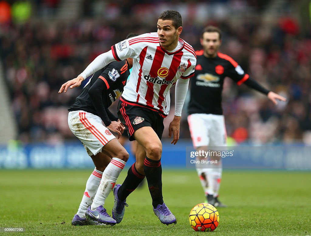 Jack Rodwell of Sunderland and Jesse Lingard of Manchester United compete for the ball during the Barclays Premier League match between Sunderland and Manchester United at the Stadium of Light on February 13, 2016 in Sunderland, England.