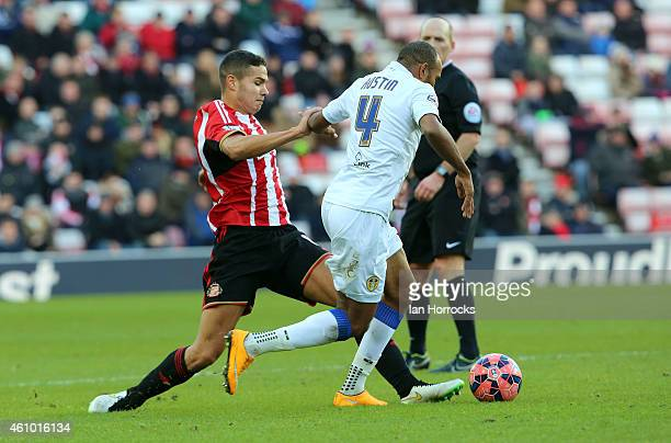 Jack Rodwell of Sunderland challenges Rodolph Austin Leeds during the FA Cup third round match between Sunderland and Leeds United at the Stadium of...