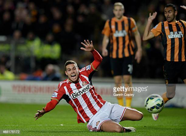 Jack Rodwell of Sunderland goes down in the Hull box and is shown a yellow card for simulation during the Barclays Premier League match between Hull...