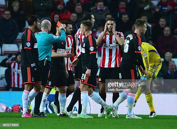 Jack Rodwell of Sunderland is shown the red card by referee Anthony Taylor during the FA Cup Fourth Round match between Sunderland and Fulham at...