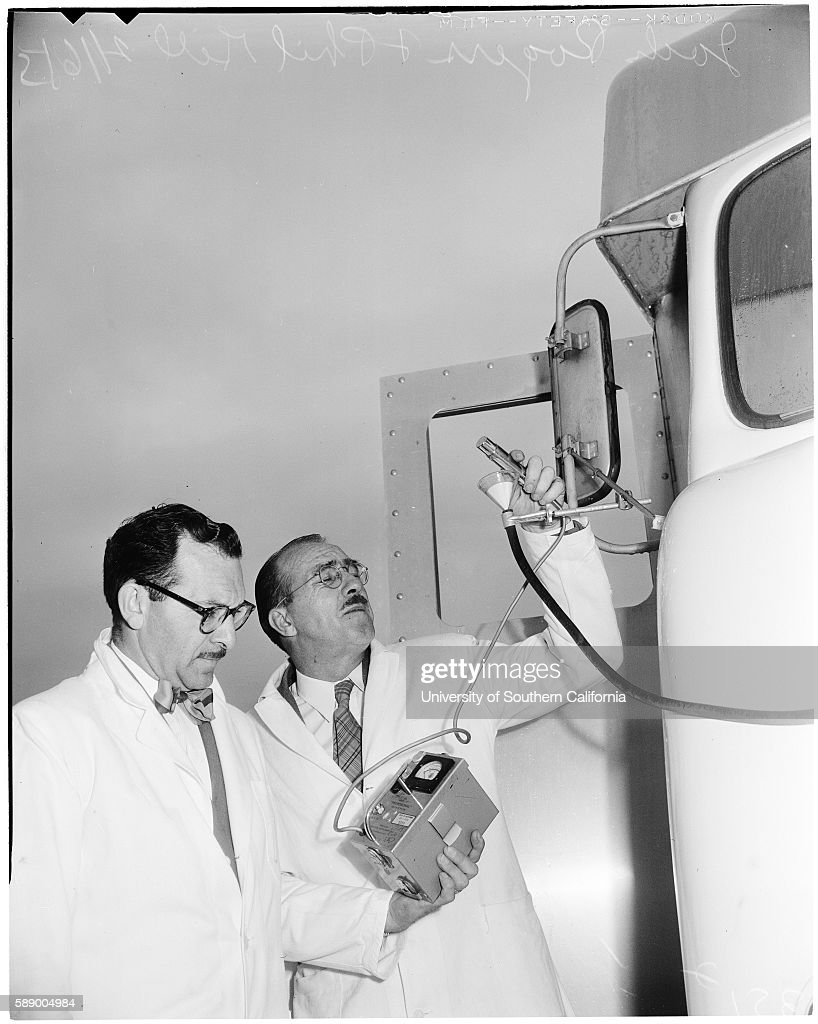 Jack Rogers holds geiger counter and Phil Gill holds geiger counter to filter paper that will trap any fallout in forthcoming Abomb tests...