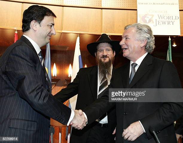 Jack Rosen Chairman of the American Jewish Congress Council for World Jewry shakes hands with Lev Leviev President of FJC CIS as Chief Rabbi of...