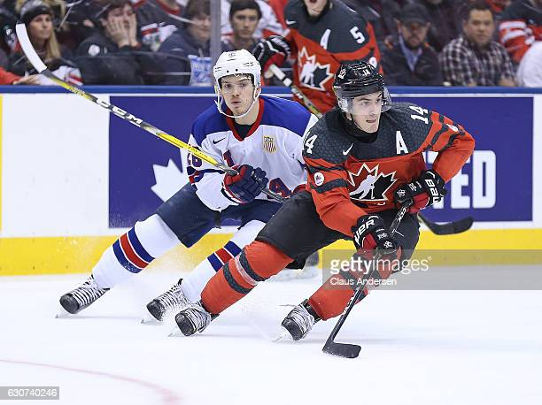 Jack Roslovic of Team USA chases after Matt Barzal of Team Canada during a preliminary round game in the 2017 IIHF World Junior Hockey Championship...
