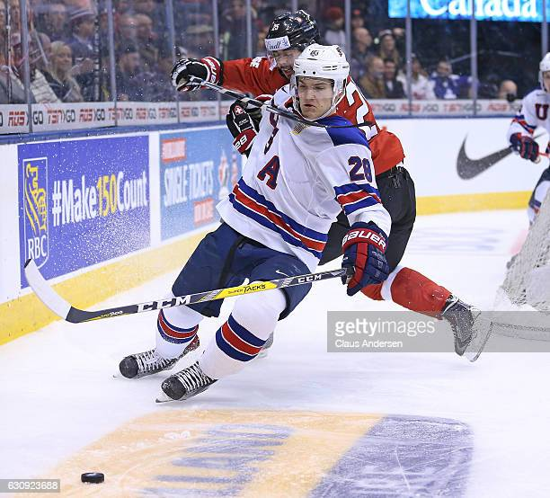 Jack Roslovic of Team USA gets hooked around the neck by Jonas Siegenthaler of Team Switzerland during a QuarterFinal game at the 2017 IIHF World...