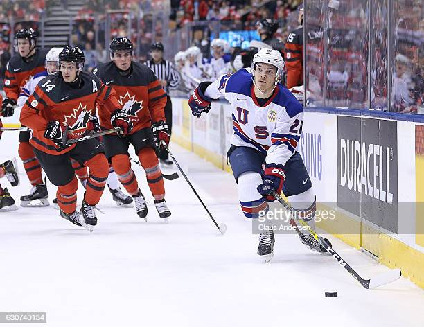 Jack Roslovic of Team USA looks to see what time is left against Team Canada during a preliminary round game in the 2017 IIHF World Junior Hockey...