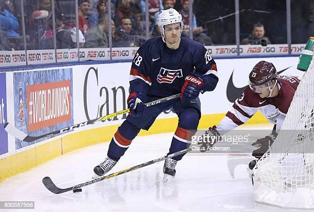 Jack Roslovic of Team USA skates against Karlis Cukste of Team Latvia during a 2017 IIHF World Junior Hockey Championship game at the Air Canada...