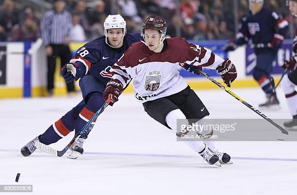 Jack Roslovic of Team USA skates against Martins Dzierkals of Team Latvia during a 2017 IIHF World Junior Hockey Championship game at the Air Canada...