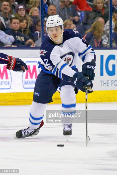 Jack Roslovic of the Winnipeg Jets controls the puck while making his NHL debut during the game against the Columbus Blue Jackets on April 6 2017 at...