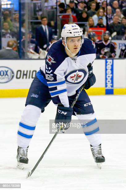 Jack Roslovic of the Winnipeg Jets lines up for a faceoff during the first period of the game against the Columbus Blue Jackets on April 6 2017 at...