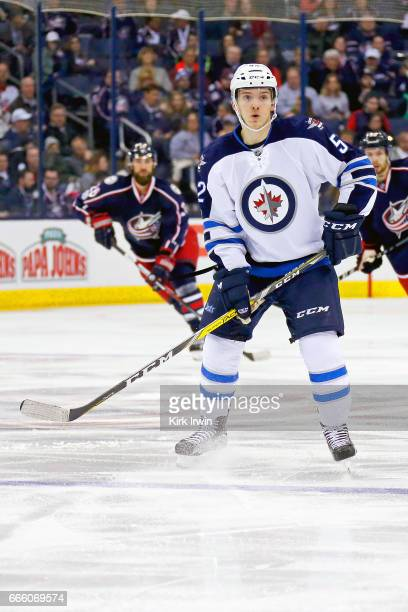 Jack Roslovic of the Winnipeg Jets skates after the puck while making his NHL debut during the game against the Columbus Blue Jackets on April 6 2017...