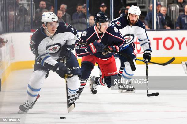 Jack Roslovic of the Winnipeg Jets skates with the puck during the second period of a game against the Columbus Blue Jackets on April 6 2017 at...