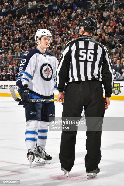 Jack Roslovic of the Winnipeg Jets talks with the linesman before a face off against the Columbus Blue Jackets on April 6 2017 at Nationwide Arena in...