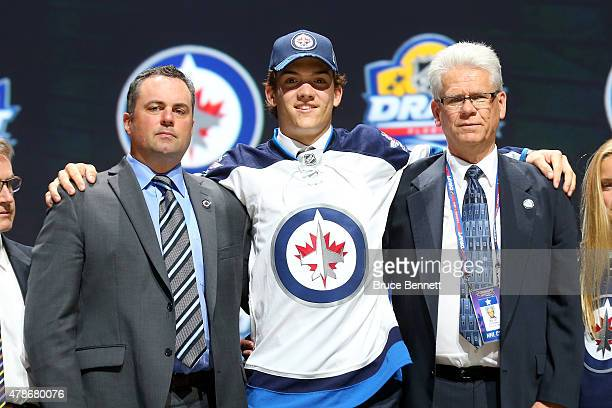 Jack Roslovic poses after being selected 25th overall by the Winnipeg Jets in the first round of the 2015 NHL Draft at BBT Center on June 26 2015 in...