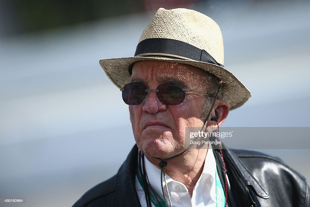 <a gi-track='captionPersonalityLinkClicked' href=/galleries/search?phrase=Jack+Roush&family=editorial&specificpeople=260209 ng-click='$event.stopPropagation()'>Jack Roush</a>, co-owner of Roush Fenway Racing, stands on the grid during qualifying for the NASCAR Sprint Cup Series Pocono 400 at Pocono Raceway on June 6, 2014 in Long Pond, Pennsylvania.