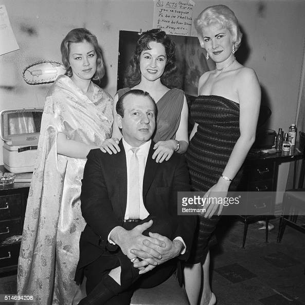 Jack Ruby killer of alleged JFK assassin Lee Harvey Oswald poses with three of the women from his burlesque club