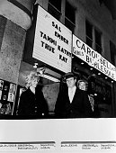 Jack Ruby stands with two of his dancers outside his nightclub the Carousel Club Jack Ruby shot Lee Harvey Oswald the suspect arrested for the murder...