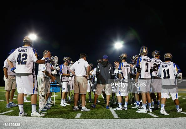 Jack Runkel Jake Tripucka and Joey Sankey of the Charlotte Hounds talk with teammates and coaches on the sidelines during a break in play against the...