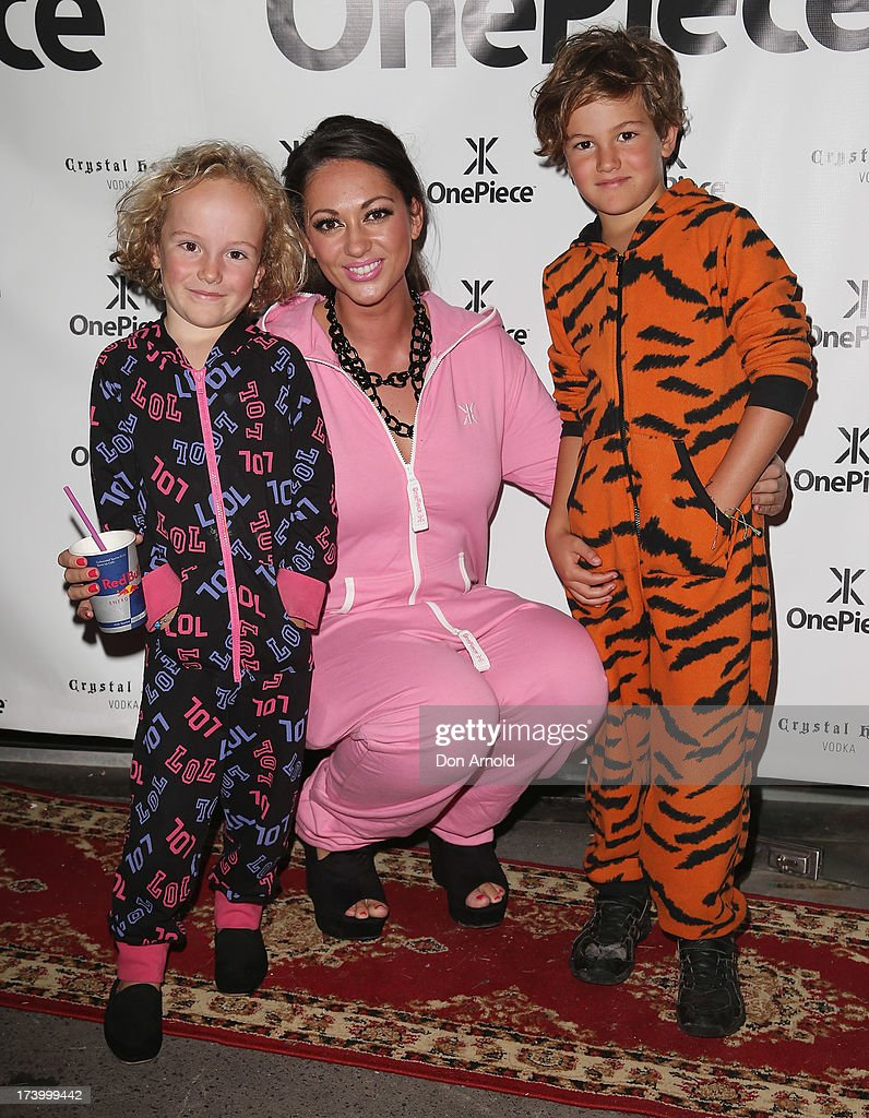 Jack Ruwald, Layla Subritzky and Finn Ruwald during the OnePiece onsie Australian launch at the Bucket List at the Bondi Beach on July 19, 2013 in Sydney, Australia.