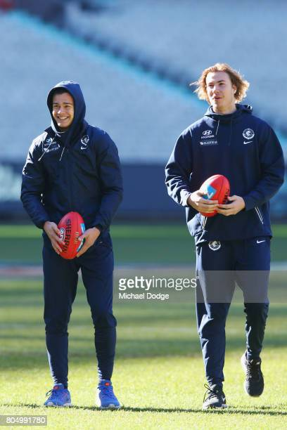 Jack Silvagni and Harry McKay of the Blues look ahead before warm up during the round 15 AFL match between the Carlton Blues and the Adelaide Crows...