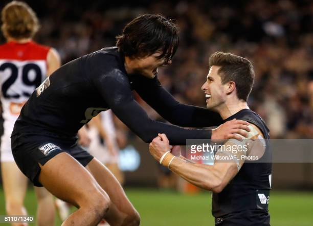 Jack Silvagni and Marc Murphy of the Blues celebrate during the 2017 AFL round 16 match between the Carlton Blues and the Melbourne Demons at the...