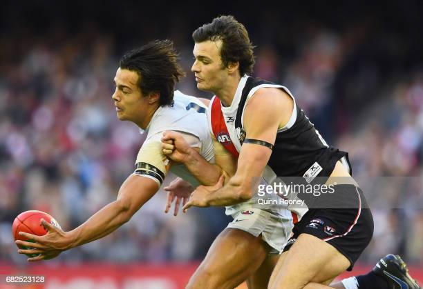 Jack Silvagni of the Blues and Dylan Roberton of the Saints compete for the ball during the round eight AFL match between the St Kilda Saints and the...