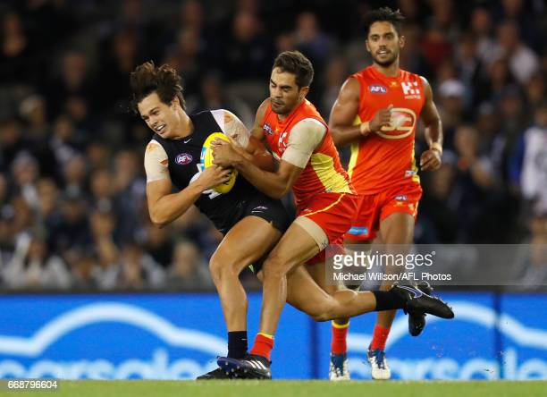 Jack Silvagni of the Blues and Jack Martin of the Suns compete for the ball during the 2017 AFL round 04 match between the Carlton Blues and the Gold...