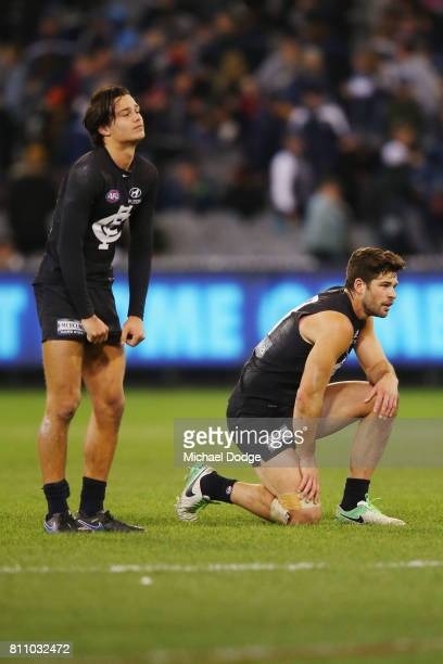 Jack Silvagni of the Blues and Levi Casboult look dejected after defeat during the round 16 AFL match between the Carlton Blues and the Melbourne...