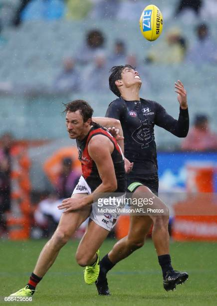 Jack Silvagni of the Blues and Mitch Brown of the Bombers compete for the ball during the 2017 AFL round 03 match between the Carlton Blues and the...