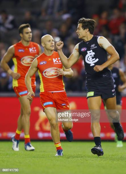 Jack Silvagni of the Blues celebrates a goal against Gary Ablett of the Suns during the round four AFL match between the Carlton Blues and the Gold...