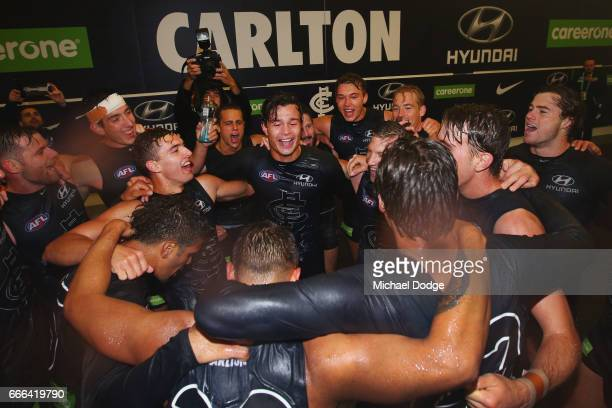 Jack Silvagni of the Blues celebrates the win with teammates during the round three AFL match between the Carlton Blues and the Essendon Bombers at...