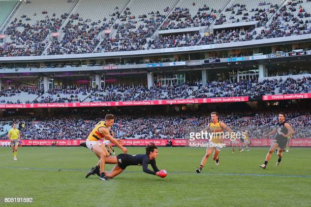 Jack Silvagni of the Blues competes for the ball during the round 15 AFL match between the Carlton Blues and the Adelaide Crows at Melbourne Cricket...