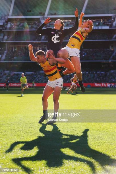 Jack Silvagni of the Blues competes for the ball over Rory Laird of the Crows during the round 15 AFL match between the Carlton Blues and the...
