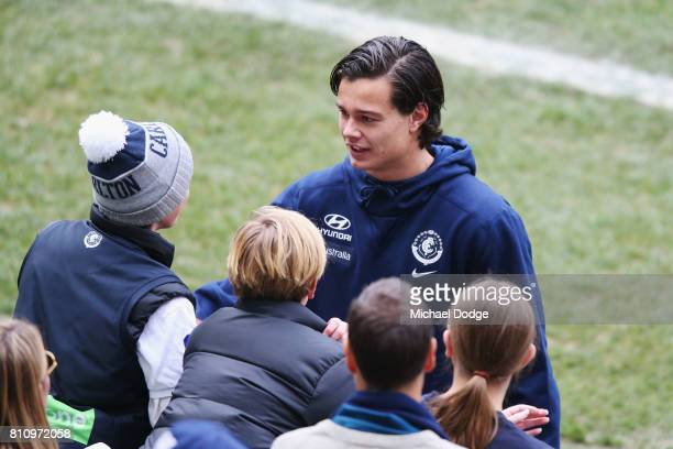 Jack Silvagni of the Blues greets fans during the round 16 AFL match between the Carlton Blues and the Melbourne Demons at Melbourne Cricket Ground...