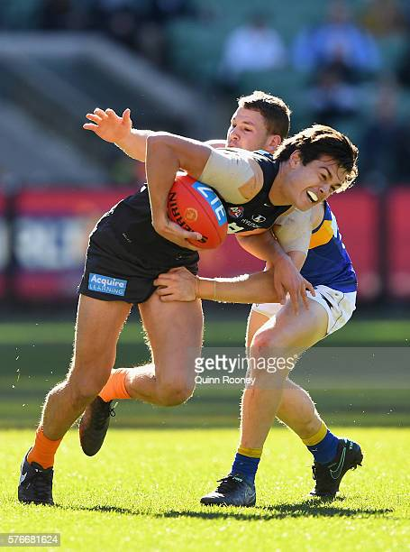 Jack Silvagni of the Blues is tackled by Jack Redden of the Eagles during the round 17 AFL match between the Carlton Blues and the West Coast Eagles...