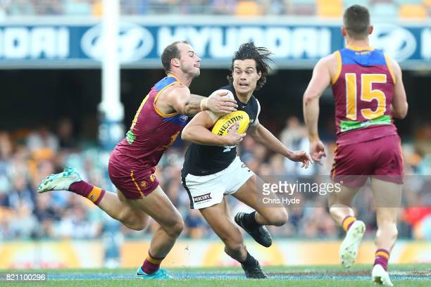 Jack Silvagni of the Blues is tackled during the round 18 AFL match between the Brisbane Lions and the Carlton Blues at The Gabba on July 23 2017 in...