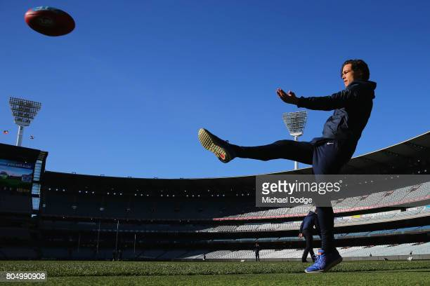 Jack Silvagni of the Blues kicks the ball before warm up during the round 15 AFL match between the Carlton Blues and the Adelaide Crows at Melbourne...