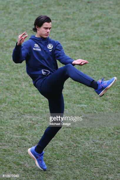 Jack Silvagni of the Blues kicks the ball during the round 16 AFL match between the Carlton Blues and the Melbourne Demons at Melbourne Cricket...