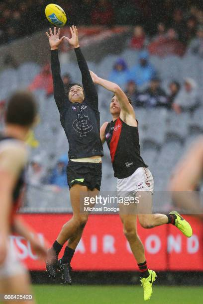 Jack Silvagni of the Blues marks the ball against Martin Gleeson of the Bombers during the round three AFL match between the Carlton Blues and the...