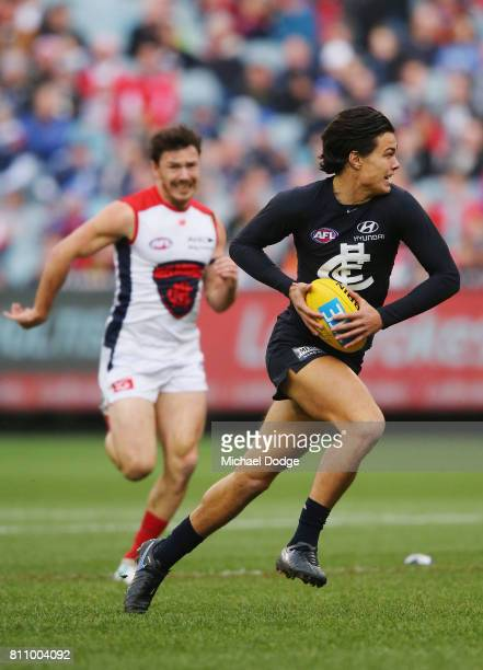 Jack Silvagni of the Blues runs the ball during the round 16 AFL match between the Carlton Blues and the Melbourne Demons at Melbourne Cricket Ground...