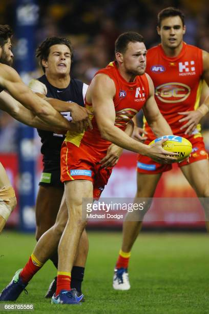 Jack Silvagni of the Blues tackles Steven May of the Suns during the round four AFL match between the Carlton Blues and the Gold Coast Suns at Etihad...