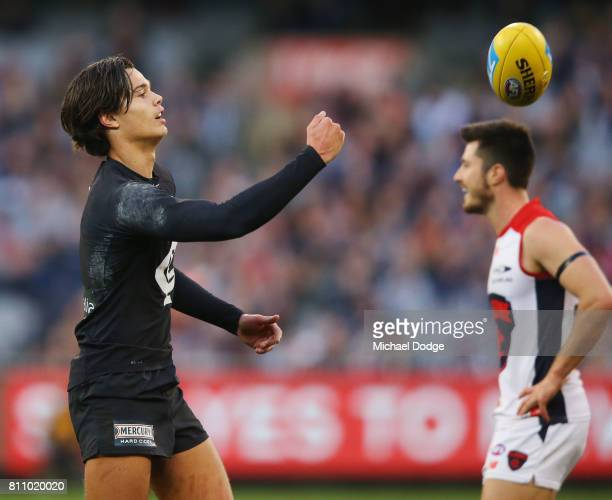 Jack Silvagni of the Blues throws the ball back after thinking he had marked the ball during the round 16 AFL match between the Carlton Blues and the...