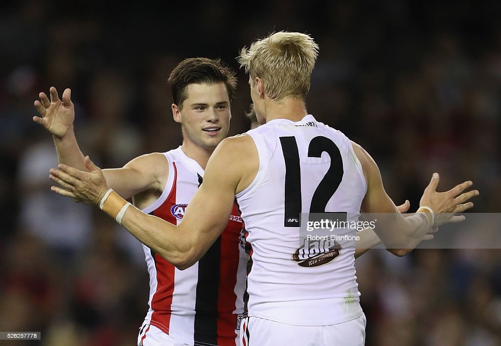Jack Sinclair of the Saints celebrates a goal with Nick Riewoldt during the round six AFL match between the Melbourne Demons and the St Kilda Saints at Etihad Stadium on April 30, 2016 in Melbourne, Australia.