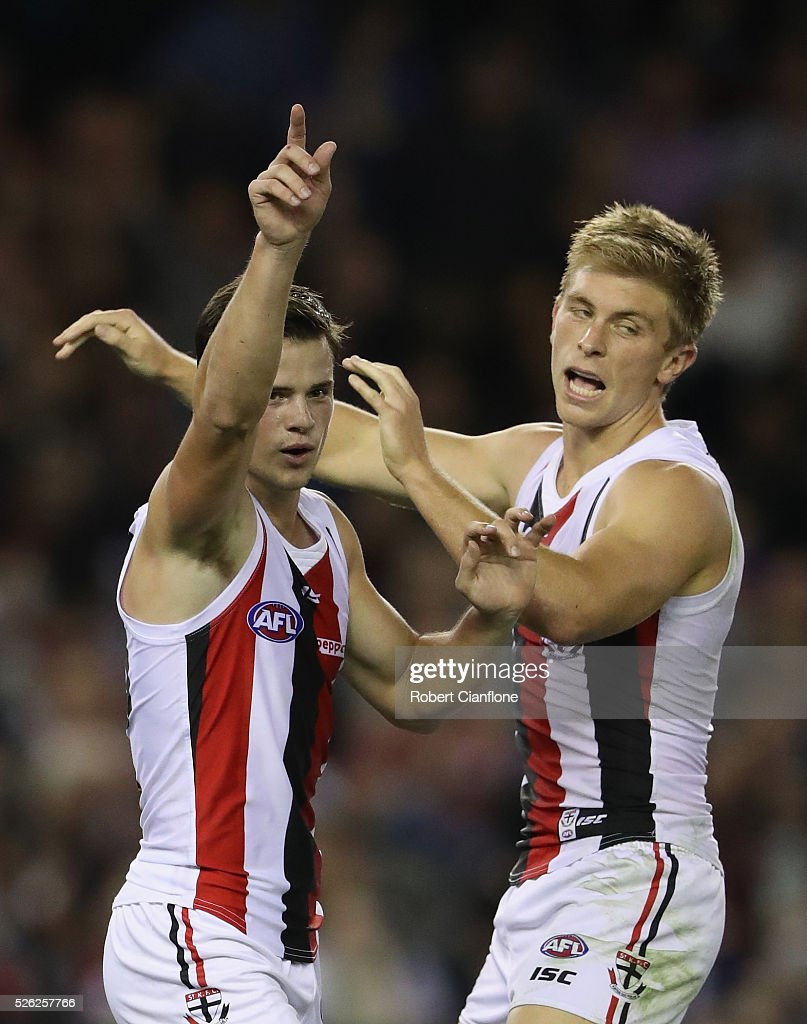 Jack Sinclair of the Saints celebrates a goal with Sebastian Ross of the Saints during the round six AFL match between the Melbourne Demons and the St Kilda Saints at Etihad Stadium on April 30, 2016 in Melbourne, Australia.