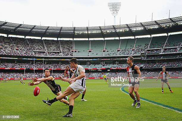 Jack Sinclair of the Saints smothers the kick of Brayden Maynard of the Magpies during the round three AFL match between the St Kilda Saints and the...